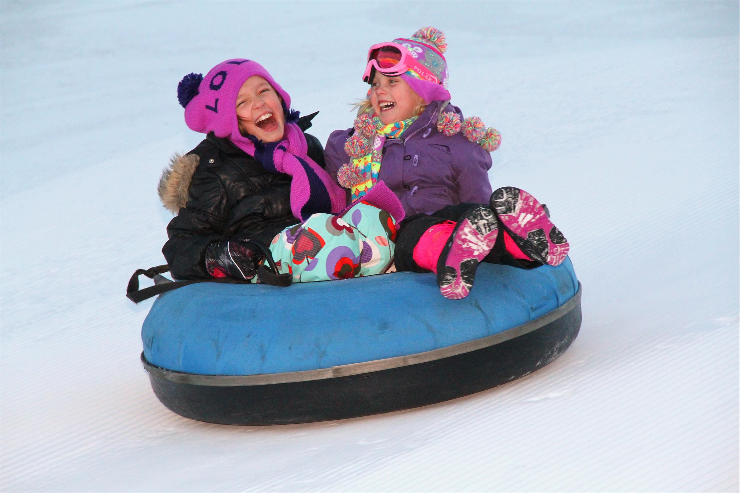 winter sports tubing girls